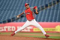 Clearwater Threshers relief pitcher Miguel Alfredo Gonzalez (48) delivers a pitch during a game against the Brevard County Manatees on June 28, 2014 at Bright House Field in Clearwater, Florida.  Brevard County defeated Clearwater 6-4.  (Mike Janes/Four Seam Images)