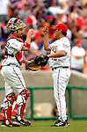 15 May 2005: Brian Schneider (left) and Chad Cordero of the Washington Nationals, celebrate victory against the Chicago Cubs, as the Nationals defeat the visiting Cubs 5-4, to take the 3-game series three games to two, at RFK Stadium in Washington, DC.  Mandatory Photo Credit: Ed Wolfstein