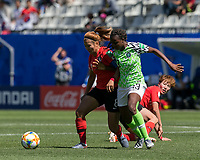 GRENOBLE, FRANCE - JUNE 12: Sohyun Cho #8 of the Korean National Team, Ngozi Okobi #13 of the Nigerian National Team battle for the ball during a game between Korea Republic and Nigeria at Stade des Alpes on June 12, 2019 in Grenoble, France.