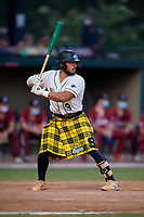 Savannah Bananas Drew Yniesta (9) bats during a Coastal Plain League game against the Macon Bacon on July 15, 2020 at Grayson Stadium in Savannah, Georgia.  Savannah wore kilts for their St. Patrick's Day in July promotion.  (Mike Janes/Four Seam Images)