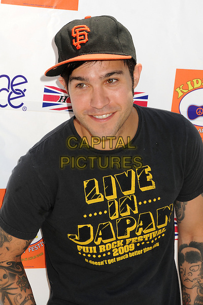 Pete Wentz.6th Annual Kidstock Music and Art Festival held at Greystone Mansion, West Hollywood, California USA..3rd June 2012.half length t-shirt yellow writing live in japan  black baseball cap hat.CAP/ADM/BP.©Byron Purvis/AdMedia/Capital Pictures.