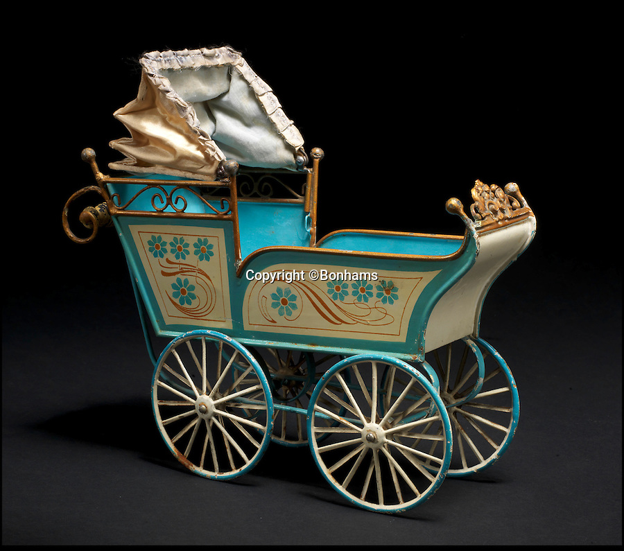 BNPS.co.uk (01202 558833)<br /> Pic: Bonhams/BNPS<br /> <br /> ***Please Use Full Byline***<br /> <br /> Large Marklin Tinplate Pram. <br /> <br /> <br /> A creepy collection of almost 100 'lifelike' dolls modelled on children has emerged for sale with a whopping half a million pounds price tag. <br /> <br /> The eerie-looking toys were made in Germany in the early 20th century as dollmakers strived to produce dolls with realistic human features.<br /> <br /> The collection of 92 dolls, which includes some of the rarest ever made, has been pieced together by a European enthusiast over the past 30 years.<br /> <br /> It is expected to fetch upwards of £500,000 when it goes under the hammer at London auction house Bonhams tomorrow (Weds).