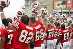 Madison, Wisconsin - 9/13/03. University of Wisconsin football team raise their helmets during the UNLV game at Camp Randall Stadium. UNLV beat Wisconsin 23-5. (Photo by David Stluka)