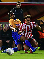Lincoln City's Kellan Gordon is fouled by Mansfield Town's Malvind Benning<br /> <br /> Photographer Chris Vaughan/CameraSport<br /> <br /> The EFL Checkatrade Trophy Group H - Lincoln City v Mansfield Town - Tuesday September 4th 2018 - Sincil Bank - Lincoln<br />  <br /> World Copyright © 2018 CameraSport. All rights reserved. 43 Linden Ave. Countesthorpe. Leicester. England. LE8 5PG - Tel: +44 (0) 116 277 4147 - admin@camerasport.com - www.camerasport.com