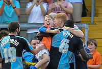 Aaron Pierre of Wycombe Wanderers (6) celebrates scoring his team's first goal to make it 1-1 during the Sky Bet League 2 match between Wycombe Wanderers and Dagenham and Redbridge at Adams Park, High Wycombe, England on 22 August 2015. Photo by David Horn.