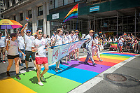 Johnson & Johnson employees in the annual Lesbian, Gay, Bisexual, Transgender and Queer (LGBTQ) Pride Parade on Fifth Avenue in New York on Sunday, June 25, 2017. Besides the corporate sponsors, politicians and various social service groups many participants carried political themed signs showing their dissatisfaction with President Trump. (© Richard B. Levine)