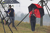 David Howell helps Ross Fisher (ENG) look for his ball in the rough on the 3rd hole during Thursday's Round 1 of the 2014 BMW Masters held at Lake Malaren, Shanghai, China 30th October 2014.<br /> Picture: Eoin Clarke www.golffile.ie