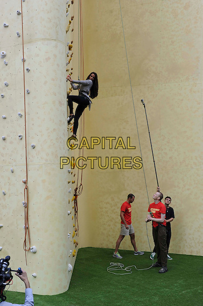 Katie Price (Jordan) .Walkers Crisp Deep Ridged Launch Climbing Wall at Truman Brewery, London, England..August 29th, 2012.full length grey gray top black leggings harness rope side sport exercise belayer belaying.CAP/CAS.©Bob Cass/Capital Pictures.