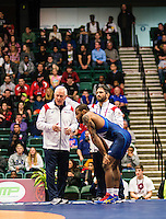 Jordan Burroughs of the United States (cq, in blue), talks with coaches Bruce Burnett (left) and Bill Zadick during a match against Carlos Arturo Izquierdo Mendez of Colombia in the final round of the Pan American Championships at Dr. Pepper Arena in Frisco, Texas, Saturday, February 27, 2016. Burroughs went on to win the match 12-2 and also win gold at the event.<br /> <br /> Photo by Matt Nager