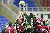 20/01/02 - Powergen  Cup - Quarter Final<br /> Madejski Stadium - Reading <br /> London Irish v Gloucester:<br /> Lone exiles player Ryan Strudwick gets his hand to the ball.[Mandatory Credit:Peter SPURRIER/Intersport Images]