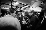London underground tube train 1970, couple crowded commuter.