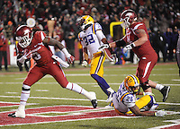 NWA Media/ANDY SHUPE - Arkansas' Alex Collins, left, carries into the end zone past LSU's Ronald Martin (26) during the fourth quarter Saturday, Nov. 15, 2014, at Razorback Stadium in Fayetteville.