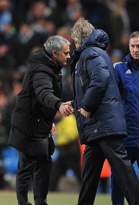 Manchester City's Manager Manuel Pellegrini shakes hands with Chelsea's Manager Jos&eacute; Mourinho at the final whistle <br /> <br /> Photo by Dave Howarth/CameraSport<br /> <br /> Football - Barclays Premiership - Manchester City v Chelsea - Monday 3rd February 2014 - Etihad Stadium - Manchester<br /> <br /> &copy; CameraSport - 43 Linden Ave. Countesthorpe. Leicester. England. LE8 5PG - Tel: +44 (0) 116 277 4147 - admin@camerasport.com - www.camerasport.com