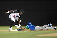 Shortstop Ronny Mauricio (2) of the Columbia Fireflies applies the tag but Michael Gigliotti (6) of the Lexington Legends is safe with a stolen base in a game on Thursday, June 13, 2019, at Segra Park in Columbia, South Carolina. Lexington won, 10-5. (Tom Priddy/Four Seam Images)