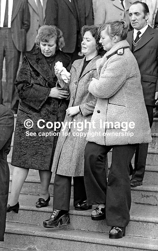 The wife of Nicholas White, from Ballysillan, Belfast, N Ireland, is comforted by her mother and sister following the funeral service. Nicholas was shot by the Provisional IRA 14th March 1976 when he opened the door of the Ardoyne community centre where he worked. A former British soldier he had married a local girl. He died in hospital the day following the shooting. His funeral service was attended by hundreds from both religeous communities. 197603170156b<br /> <br /> Copyright Image from Victor Patterson, 54 Dorchester Park, Belfast, UK, BT9 6RJ<br /> <br /> Tel: +44 28 9066 1296<br /> Mob: +44 7802 353836<br /> Voicemail +44 20 8816 7153<br /> Email: victorpatterson@me.com<br /> Email: victorpatterson@gmail.com<br /> <br /> IMPORTANT: My Terms and Conditions of Business are at www.victorpatterson.com