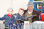 Ben and Charlie Brosnan with their grandfather Charlie Moriarty Currow at the Castlemaine Vintage show on Sunday..