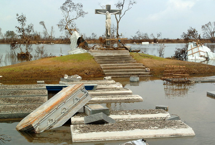 Graves were popped from the flooded soil during Hurricane Rita at Our Lady Star of the Sea Church in Cameron, LA. Many of the graves belong to those killed in Hurricane Audrey in 1957 when over 500 people perished in the storm. September 29, 2005.