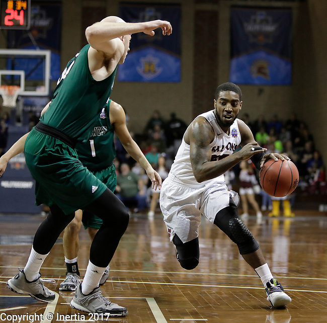 SIOUX FALLS, SD: MARCH 25:  Shammgod Wells #55 of Fairmont State drives toward Northwest Missouri State defenders during the Men's Division II Basketball Championship game on March 25, 2017 at the Denny Sanford Premier Center in Sioux Falls, SD. (Photo by Dick Carlson/Inertia)