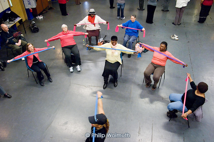 Chair-based exercise session at Open Age open day at Paddington Arts