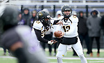 SIOUX FALLS, SD - NOVEMBER 10: Marlon Warren #22 from Wayne State takes the handoff from quarterback Brady Brandsfield #13 during their game against the University of Sioux Falls Saturday afternoon at Bob Young Field in Sioux Falls. (Photo by Dave Eggen/Inertia)