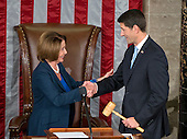 Incoming Speaker of the United States House of Representatives Paul Ryan (Republican of Wisconsin), right, accepts the gavel from former Speaker of the US House of Representatives and current US House Minority Leader Nancy Pelosi (Democrat of California), left, in the US House Chamber in the US Capitol in Washington, DC on Thursday, October 29, 2015.<br /> Credit: Ron Sachs / CNP