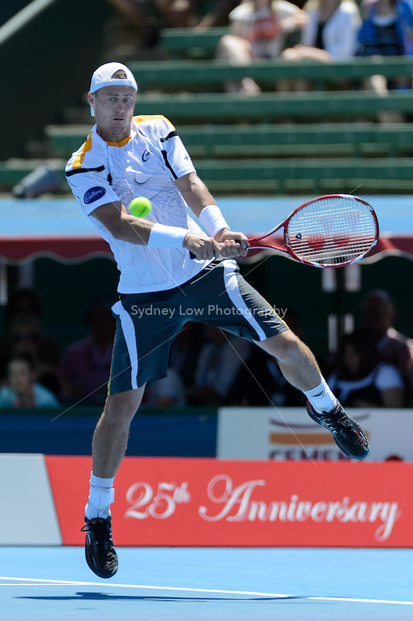 MELBOURNE, AUSTRALIA - JANUARY 10: LLEYTON HEWITT (AUS) in action against TOMAS BERDYCH (CZE) on day 2 of the 2013 AAMI Classic event at the Kooyong Lawn Tennis Club in Melbourne, Australia. Hewitt won 6-3 6-2.