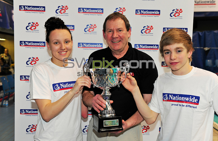 PICTURE BY SIMON WILKINSON/SWPIX.COM...Disability Swimming -  DSE Junior Swimming Championships 2011 - Ponds Forge, Sheffield, England - 27/02/11...Winning team East Region James Hollis and Lauren Smith with Charles Reed.