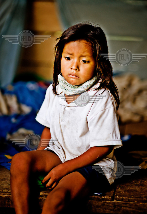 A young girl in Kapawi having a miserable morning. From an outsider's perepective it would be easy to imagine that a girl of this age doesn't have much to look forward to beyond chewing up chicha and watching her spit ferment from  underneath the scales of an imbalanced gender dynamic. The woman do, however, manage to subvert a lot of male domination by partaking in unspoken, communal acts of disobedience in which they can trap their miscreant husbands within complex webs of social role play. A woman can, for example, pretend not to hear a call for more chicha and, in doing so, simultaneously embarass and immobilise her husband who can neither raise his voice nor ignore the situation without appearing weak and unable to keep order even within his own household.