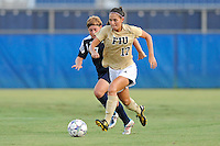 27 August 2011:  FIU's Deana Rossi (17) moves the ball upfield while being pursued by Akron's Ashley Hughes (7) in the first half as the FIU Golden Panthers defeated the University of Arkon Zips, 1-0, at University Park Stadium in Miami, Florida.