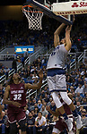 Nevada  forward Trey Porter (15) dunks the ball against Little Rock in the second half of an NCAA college basketball game in Reno, Nev., Friday, Nov. 16, 2018. (AP Photo/Tom R. Smedes)