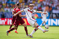 Per Mertesacker of Germany and Hugo Almeida of Portugal