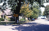 Port Gamble, WA.: Street view looking north to mill, port, Post Office and store. Architecture reflects East Machias, ME., origin of founders. Photo '88.