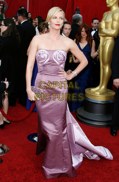 CHARLIZE THERON.The 82nd Annual Academy Awards held aat The Kodak Theatre in Hollywood, California, USA..March 7th, 2010.oscars full length pink two tone bustier bodice maxi gown couture fishtail silk satin strapless hand on hip.CAP/EAST.©Eastman/Capital Pictures.