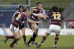 Kristian Ormsby takes on Blair Stewart & Phil Dawson during the Air NZ Cup game between the Counties Manukau Steelers and Southland played at Mt Smart Stadium on 3rd September 2006. Counties Manukau won 29 - 8.
