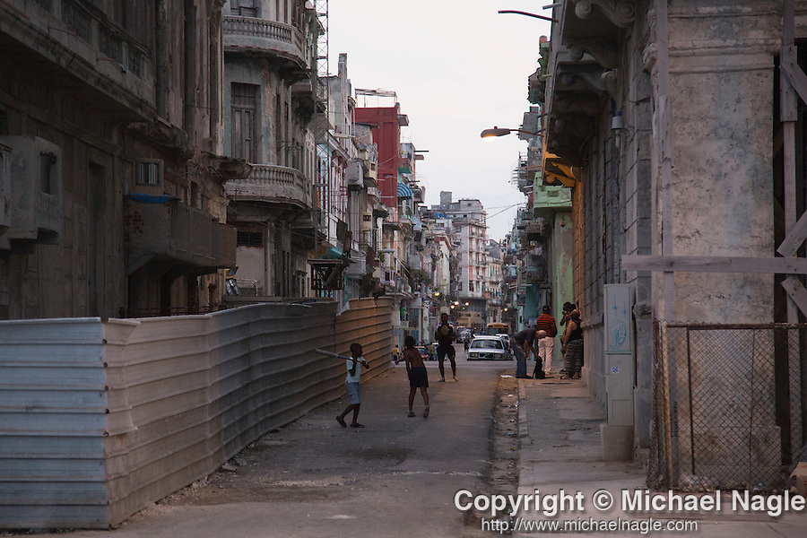 HAVANA, CUBA -- MARCH 23, 2015:  Boys play baseball in Havana, Cuba on March 23, 2015. Photograph by Michael Nagle