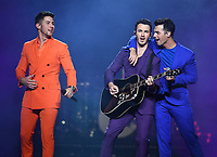 MIAMI, FL - AUGUST 07: Nick Jonas, Kevin Jonas and Joe Jonas of the Jonas Brothers perform during opening night of the 'Happiness Begins Tour' at the AmericanAirlines Arena on August 7, 2019 in Miami Florida. <br /> CAP/MPI04<br /> ©MPI04/Capital Pictures