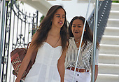 Malia and Sasha Obama depart ahead of their parents United States President Barack Obama and first lady Michelle Obama depart the White House in Washington, DC on Saturday, August 6, 2016 to travel to Martha's Vineyard, Massachusetts for their annual two week vacation.  <br /> Credit: Ron Sachs / Pool via CNP