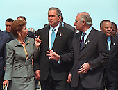 United States President George W. Bush, center, talks with President Mireya Moscoso of Panama, left, and President Fernando de la Rua of Argentina, right, prior to the offical group photo at the Citadelle during the Summit of the Americas, Quebec City, Canada on Saturday, April 21, 2001..Mandatory Credit: Paul Morse - White House via CNP