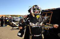 Jul. 17, 2010; Sonoma, CA, USA; NHRA top fuel dragster driver Tony Schumacher puts on his safety gear during qualifying for the Fram Autolite Nationals at Infineon Raceway. Mandatory Credit: Mark J. Rebilas-