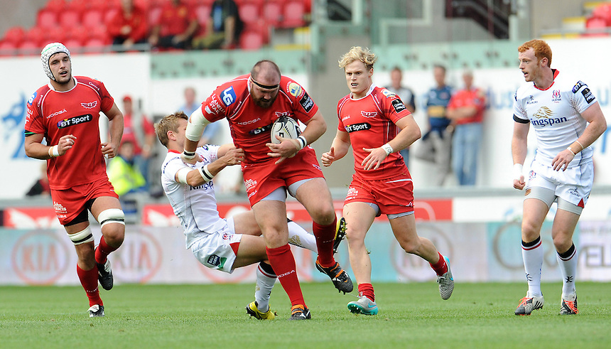 Scarlets' Phil John is tackled by Ulster's Paul Marshall<br /> <br /> Photographer Ian Cook/CameraSport<br /> <br /> Rugby Union - Guinness PRO12 - Scarlets v Ulster - Saturday 12th September 2015 - Parc y Scarlets - Llanelli<br /> <br /> &copy; CameraSport - 43 Linden Ave. Countesthorpe. Leicester. England. LE8 5PG - Tel: +44 (0) 116 277 4147 - admin@camerasport.com - www.camerasport.com