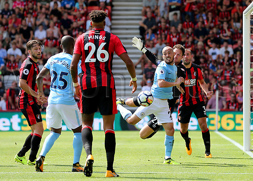 26th August 2017, Vitality Stadium, Bournemouth, England; EPL Premier League football, Bournemouth versus Manchester City;   Bournemouth Goalkeeper Asmir Begovic palms away a cross as David Silva of Manchester City looks to head the ball in