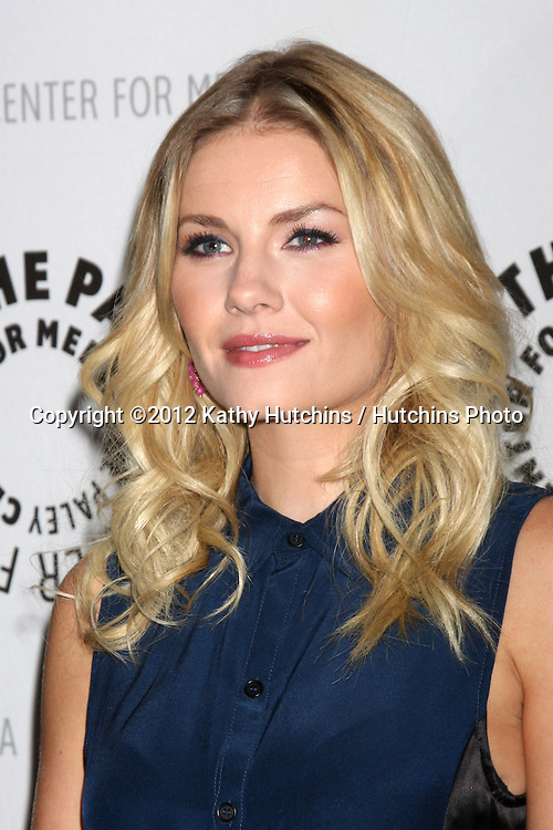 """LOS ANGELES - OCT 16:  Elisha Cuthbert arrives at  An Evening With """"Happy Endings"""" And """"Don't Trust The B---- In Apartment 23"""" at Paley Center For Media on October 16, 2012 in Beverly Hills, CA"""