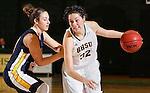 JANUARY 30, 2015 -- Dakota Barrie #32 of Black Hills State drives on Jessica Ramos #20 of Regis University during their Rocky Mountain Athletic Conference women's basketball game Friday evening at the Donald E. Young Center in Spearfish, S.D.  (Photo by Dick Carlson/Inertia)