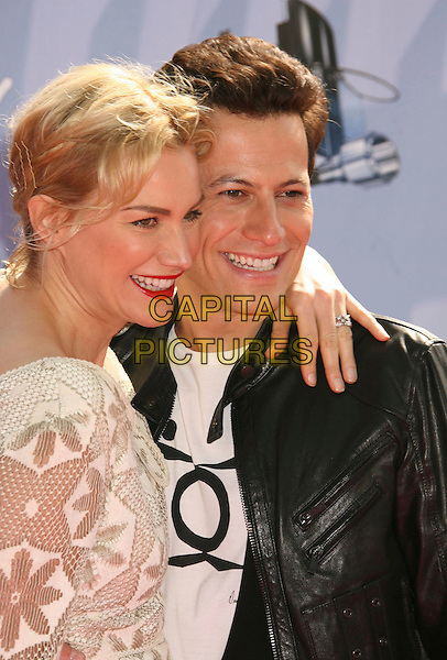 ALICE EVANS & IOAN GRUFFUDD .2007 MTV Movie Awards held at the Gibson Amphitheater, Universal City, California, USA..June 3rd, 2007.half length black jacket leather kirby grip clip red lipstick couple white flower floral lace dress  .CAP/ADM/RE.©Russ Elliot/AdMedia/Capital Pictures *** Local Caption *** ...