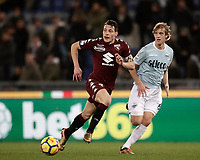 Calcio, Serie A: Roma, stadio Olimpico, 11 dicembre 2017.<br /> Torino's captain Andrea Belotti (l) in action with Lazio's Dusan Basta (r) during the Italian Serie A football match between Lazio and Torino at Rome's Olympic stadium, December 11, 2017.<br /> UPDATE IMAGES PRESS/Isabella Bonotto