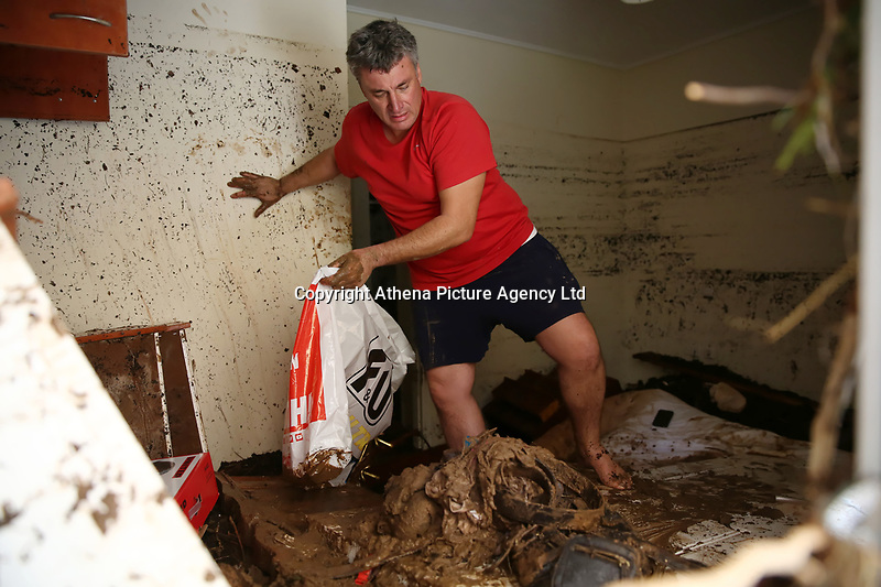 Pictured: A man tries to negotiate through mud in his property caused by heavy rain in the area of Kinetta, near Athens, Greece. Monday 25 November<br /> Re: Heavy overnight rainfall has caused flooding and landslides in parts of Greece.