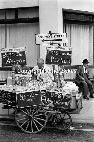 Street vendor selling Fresh Roasted Peanuts and Honeycombe. Clerkenwell, London EC1 UK 1970s Britain...My ref 17/ 261/, 1971,