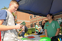 NWA Democrat-Gazette/FLIP PUTTHOFF<br /> WARM NWACC WELCOME<br /> Kaleb Woodell (left) selects free items Wednesday August 26 2015 with help from April Kelley, a student ambassador at Northwest Arkansas Community College at the college's Student Welcome Week event. Games, food, vendor exhibits and information about NWACC programs were part of the event, organized by the Student Ambassador and Activities Board. &quot;It's an opportunity for students to have fun and get acquaited with the college,&quot; said Becky Hudson, NWACC director of student life. Welcome events continue today at the college.