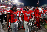 Ohio State Buckeyes running back Jordan Hall (7) and cornerback Bradley Roby (1) walk off the field following the Buckeyes' 63-14 win over Penn State in the NCAA football game at Ohio Stadium in Columbus on Oct. 26, 2013. (Adam Cairns / The Columbus Dispatch)