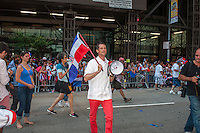 NYC Mayoral candidate and disgraced congressman Anthony Weiner  joins thousands of Dominican-Americans and their friends and supporters as he campaigns in the Dominican Day Parade in New York on Sixth Avenue on Sunday, August 11, 2013.  Politicians, flags and cultural pride were on display at the annual event. Weiner's poll numbers have recently fallen to 10 percent placing him fourth in the field of Democratic candidates for New York mayor. The primary election is approximately one month away. (© Richard B. Levine)